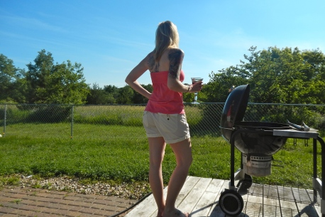 Me enjoying the view of our backyard with some wine