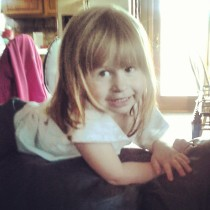 Sweet Evie climbing on the couch